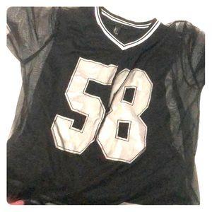 A netted overlay Jersey shirt
